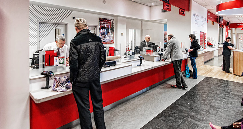 An image of people queuing at the post office.
