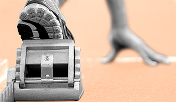 Cropped image of runner on the starting blocks
