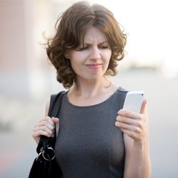 Woman confused by what's happening on her cellphone