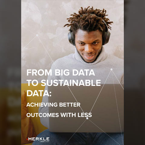 """White paper front cover thumnail for """"From big data to sustainable data: achieving better outcomes with less"""", featuring a casually dressed man, wearing headphones, looking at a laptop, with a positive expression."""