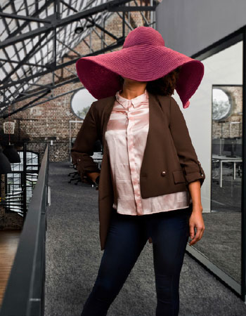 Woman wearing very large hat that clearly doesn't fit