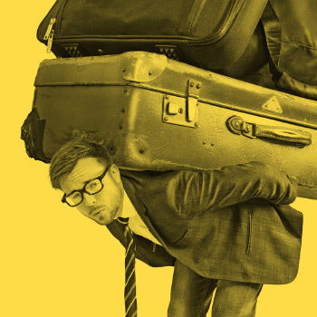 Business person (wearing suit and tie) struggling under the weight of large suitcases