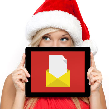An image of a woman wearing a Santa hat holding a tablet with an email icon