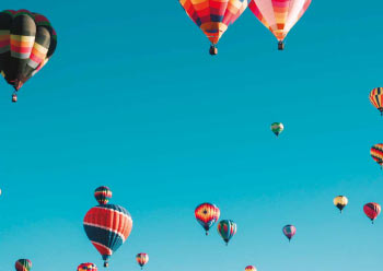 Many hot air balloons in the sky