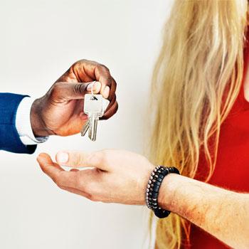 Keys benig handed to homeowner