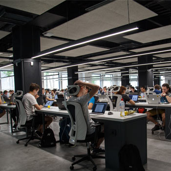 Modern office, with people sat at desks