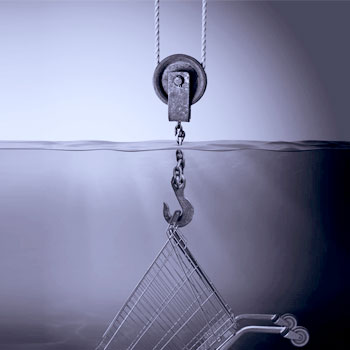 A hook rescuing a shopping trolley from water