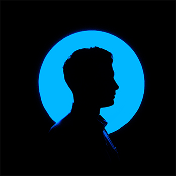 Silhouetted figure against blue circle