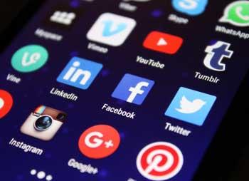 Social app icons on phone screen, closeup