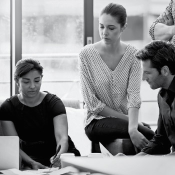 Team of office workers discussing context