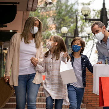 Consumer Spending Priorities - Family, wearing face masks, out shopping